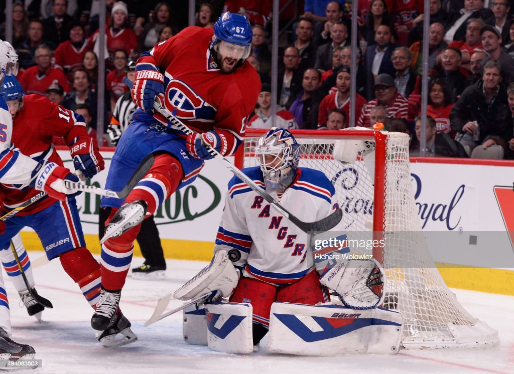 <a gi-track='captionPersonalityLinkClicked' href=/galleries/search?phrase=Max+Pacioretty&family=editorial&specificpeople=4324972 ng-click='$event.stopPropagation()'>Max Pacioretty</a> #67 of the Montreal Canadiens screens <a gi-track='captionPersonalityLinkClicked' href=/galleries/search?phrase=Henrik+Lundqvist&family=editorial&specificpeople=217958 ng-click='$event.stopPropagation()'>Henrik Lundqvist</a> #30 of the New York Rangers during Game Five of the Eastern Conference Final in the 2014 NHL Stanley Cup Playoffs at Bell Centre on May 27, 2014 in Montreal, Canada.