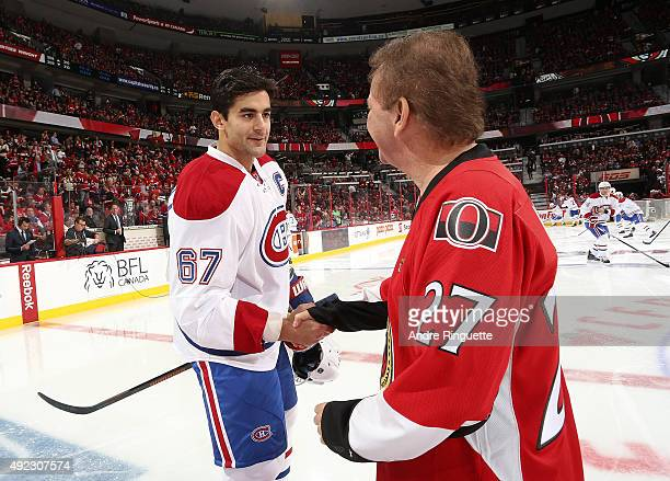 Max Pacioretty of the Montreal Canadiens shakes hands with Ottawa Senators owner Eugene Melnyk after a pre game ceremony at Canadian Tire Centre on...