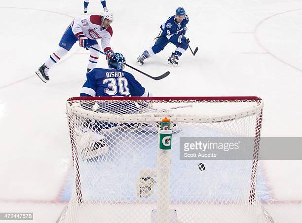 Max Pacioretty of the Montreal Canadiens shoots the puck by goalie Ben Bishop of the Tampa Bay Lightning for a short handed goal during the first...