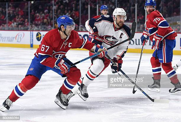 Max Pacioretty of the Montreal Canadiens skates against Nick Foligno of the Columbus Blue Jackets in the NHL game at the Bell Centre on December 1...