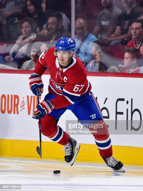 Max Pacioretty of the Montreal Canadiens skates the puck against the Chicago Blackhawks during the NHL game at the Bell Centre on October 10 2017 in...