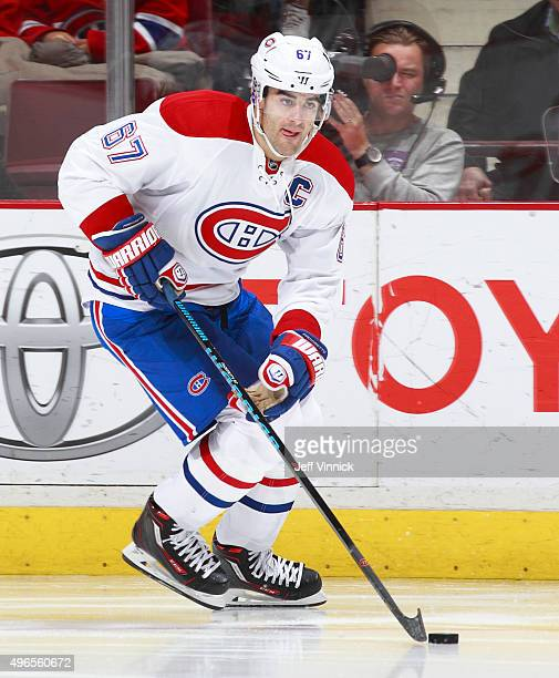 Max Pacioretty of the Montreal Canadiens skates up ice with the puck during their NHL game against the Vancouver Canucks at Rogers Arena October 27...
