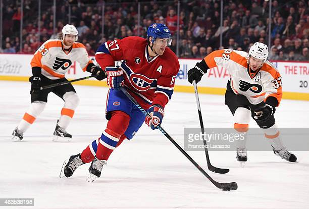 Max Pacioretty of the Montreal Canadiens skates with the puck against Mark Streit of the Philadelphia Flyers in the NHL game at the Bell Centre on...