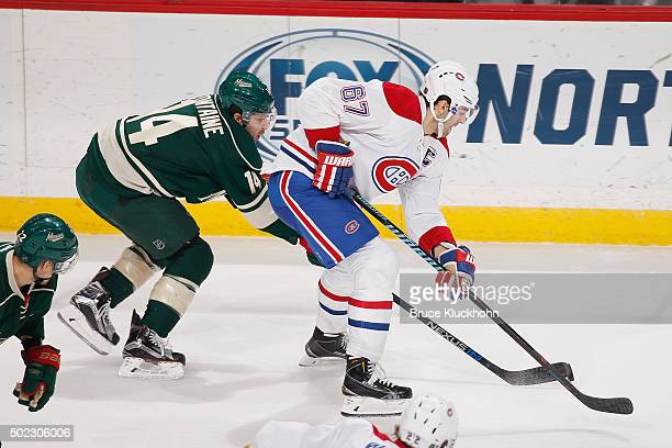 Max Pacioretty of the Montreal Canadiens skates with the puck while Justin Fontaine of the Minnesota Wild defends during the game on December 22 2015...