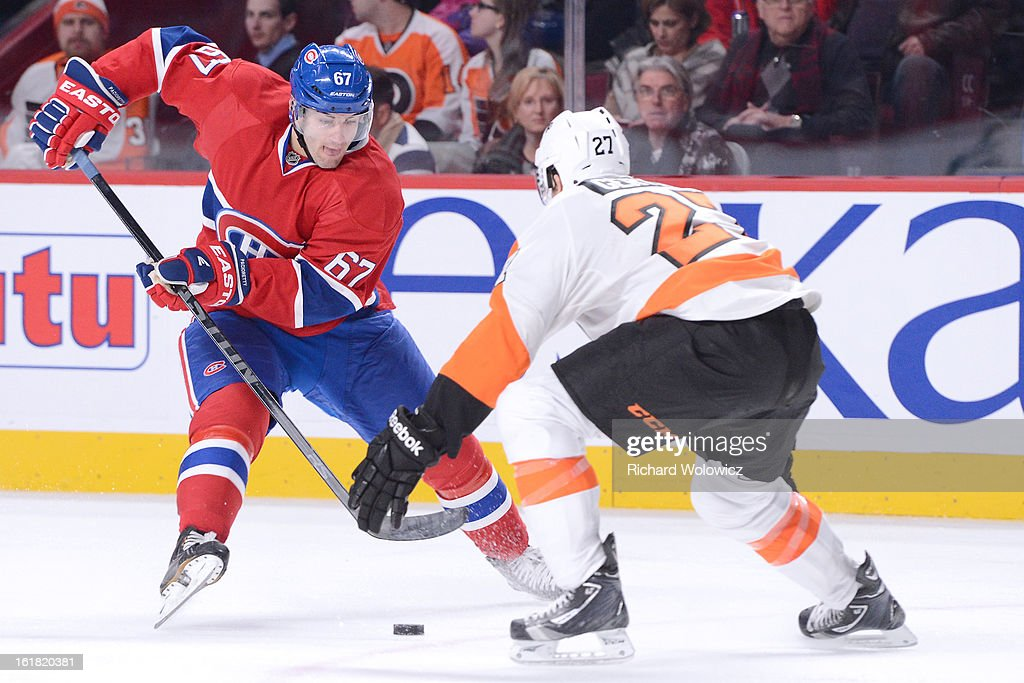 <a gi-track='captionPersonalityLinkClicked' href=/galleries/search?phrase=Max+Pacioretty&family=editorial&specificpeople=4324972 ng-click='$event.stopPropagation()'>Max Pacioretty</a> #67 of the Montreal Canadiens stick handles the puck past <a gi-track='captionPersonalityLinkClicked' href=/galleries/search?phrase=Bruno+Gervais&family=editorial&specificpeople=215079 ng-click='$event.stopPropagation()'>Bruno Gervais</a> #27 of the Philadelphia Flyers during the NHL game at the Bell Centre on February 16, 2013 in Montreal, Quebec, Canada. The Canadiens defeated the Flyers 4-1.