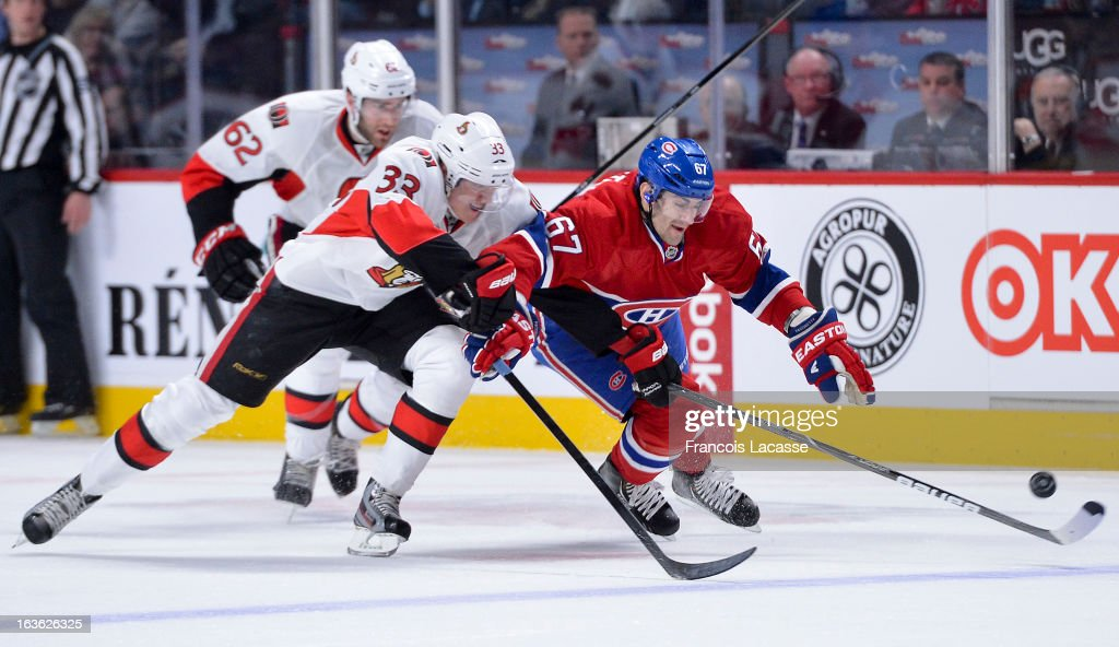 <a gi-track='captionPersonalityLinkClicked' href=/galleries/search?phrase=Max+Pacioretty&family=editorial&specificpeople=4324972 ng-click='$event.stopPropagation()'>Max Pacioretty</a> #67 of the Montreal Canadiens tries to fight his way past <a gi-track='captionPersonalityLinkClicked' href=/galleries/search?phrase=Jakob+Silfverberg&family=editorial&specificpeople=5894639 ng-click='$event.stopPropagation()'>Jakob Silfverberg</a> #33 of the Ottawa Senators during the NHL game on March 13, 2013 at the Bell Centre in Montreal, Quebec, Canada.