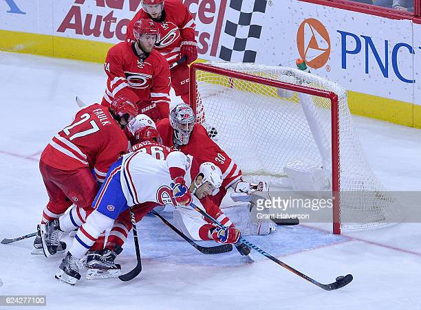 Max Pacioretty of the Montreal Canadiens works to score against Justin Faulk Teuvo Teravainen and Cam Ward of the Carolina Hurricanes during the game...