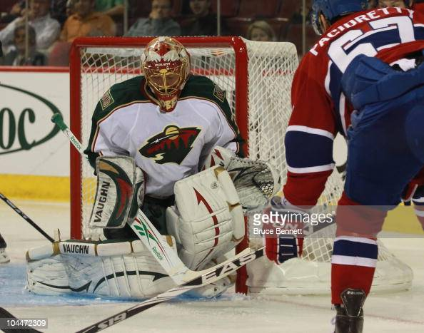 Max Pacioretty of the Montreal is stopped by goaltender Anton Khudobin of the Minnesota WildCanadiens at the Bell Centre on September 26 2010 in...