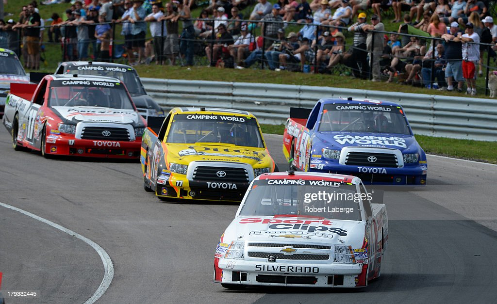 <a gi-track='captionPersonalityLinkClicked' href=/galleries/search?phrase=Max+Papis&family=editorial&specificpeople=226808 ng-click='$event.stopPropagation()'>Max Papis</a> of Italy, driver of the #14 Sport Clips Chevrolet, leads a pack of cars during the NASCAR Camping World Truck Series Chevrolet Silverado 250 at the Canadian Tire Motorsports Park on September 1, 2013 in Bowmanville, Ontario, Canada.