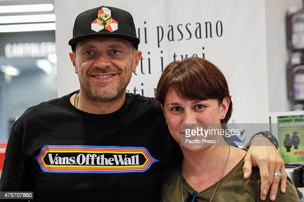 Max Pezzali with a fan The Italian singer Max Pezzali former leader of the group 883 signed copies of his latest album 'Spaceship Max' to Mondadori...