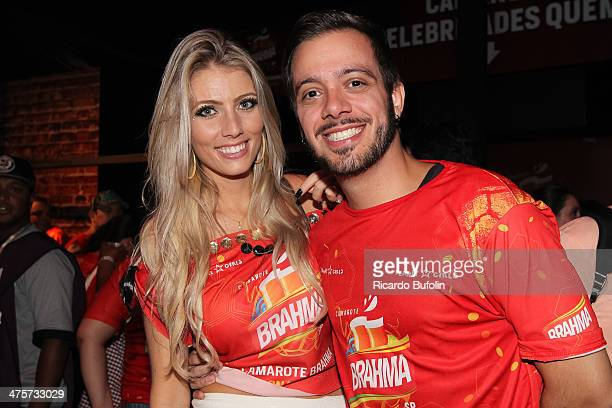 Max Porto winner of reality show Big Brother Brasil 9 with his girlfriend Ariane Cerqueira attend the first night of the Sao Paulo's Carnival parade...