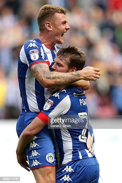 Max Power and Nick Powell of Wigan Athletic celebrate Powell's goal during the Sky Bet Championship League match between Wigan Athletic and Blackburn...