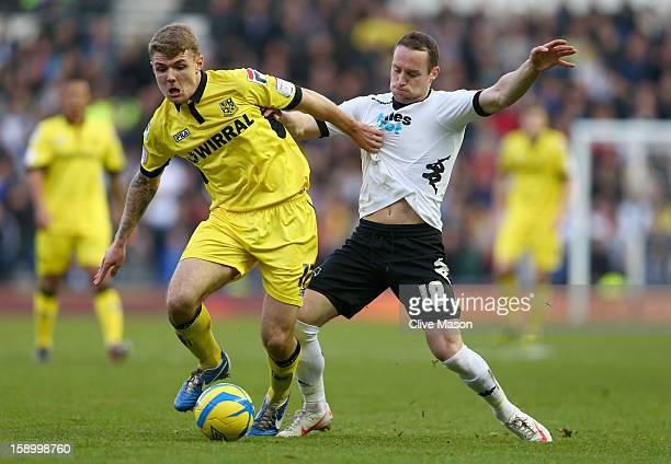Max Power of Tranmere Rovers is tackled by Ben Davies of Derby County during the FA Cup with Budweiser Third Round match between Derby County and...