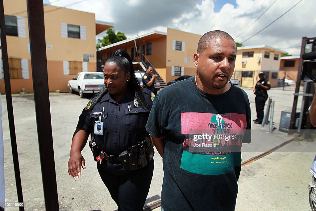 Max Rameau is led away by a City of Miami police officer when he was arrested during a protest against the evictions being carried out at an apartment complex on June 15, 2010 in Miami, Florida. Rameau, who is the cofounder of the activist movement Take Back the Land, tried to prevent the eviction of tenants from the complex but was unsuccessful. According to the activists, the bank, which now owns the apartment complex, is forcing the current residents out and they have no other homes to move to.