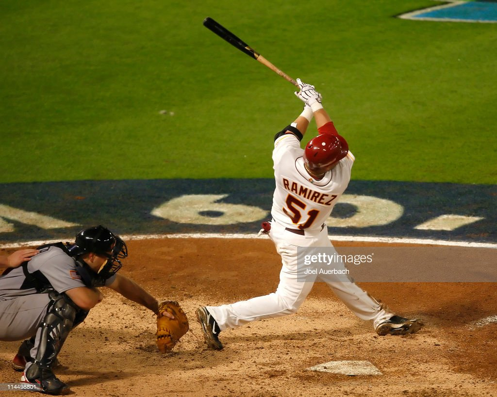 <a gi-track='captionPersonalityLinkClicked' href=/galleries/search?phrase=Max+Ramirez&family=editorial&specificpeople=4175170 ng-click='$event.stopPropagation()'>Max Ramirez</a> #51 of Venezuela hits a three run home run against the USA during the World Baseball Classic at Dolphin Stadium on March 18, 2009 in Miami, Florida. Venezuela defeated the USA