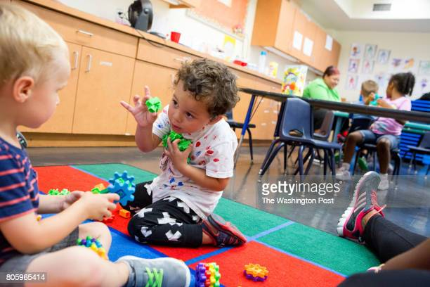 Max Raven center plays with classmates at Brentwood Recreation Center's Little Explorer day camp for children ages three to five in Washington DC...