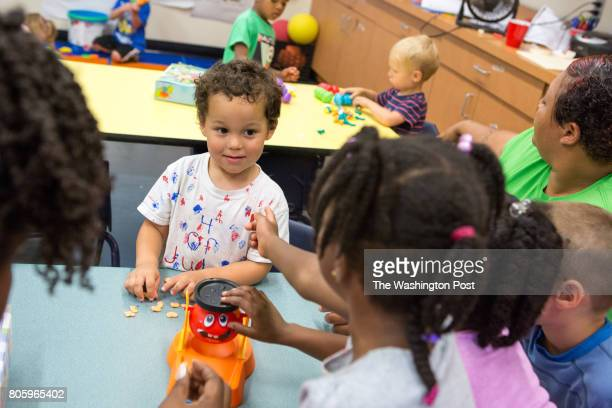 Max Raven plays with classmates at Brentwood Recreation Center's Little Explorer day camp for children ages three to five in Washington DC June 30...