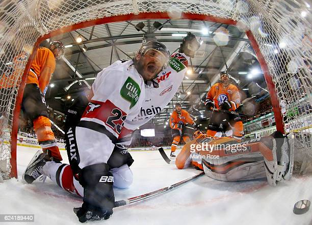 Max Reinhart of Koeln celebrates after scoring the 4th goal during the DEL match between Grizzly Wolfsburg and Koelner Haie at BraWo Ice Arena on...