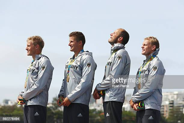 Max Rendschmidt Tom Liebscher Max Hoff and Marcus Gross of Germany celebrate winning the gold medal in the Men's Kayak Four 1000m Finals on Day 15 of...