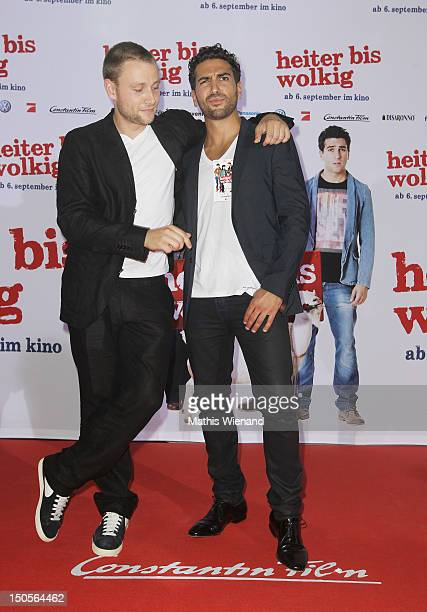 Max Riemelt and Elyas M'Barke attend the 'Heiter Bis Wolkig' Germany Premiere at Cinedome on MediaPark on August 21 2012 in Cologne Germany