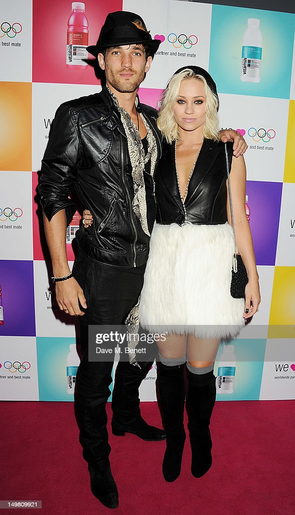 Max Rogers (L) and Kimberly Wyatt arrive as Glaceau vitaminwater presents 'Jessie J Live In London' at The Roundhouse on August 4, 2012 in London, England.