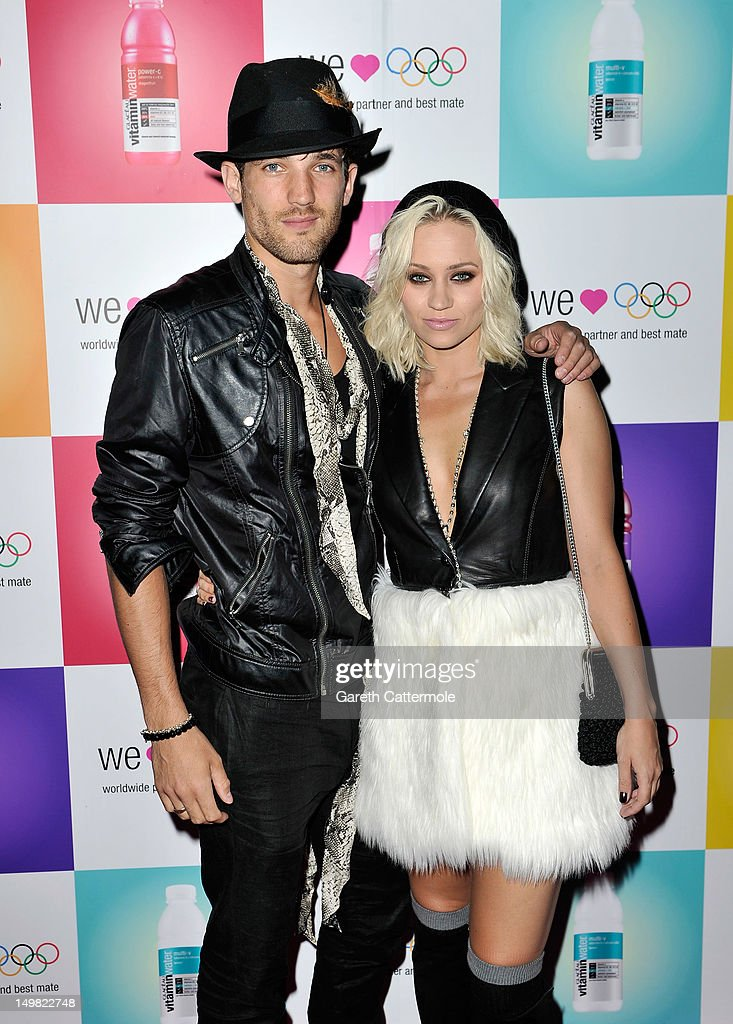 Max Rogers (L) and <a gi-track='captionPersonalityLinkClicked' href=/galleries/search?phrase=Kimberly+Wyatt&family=editorial&specificpeople=678958 ng-click='$event.stopPropagation()'>Kimberly Wyatt</a> arrive as Glaceau vitaminwater presents 'Jessie J Live In London' at The Roundhouse on August 4, 2012 in London, England.