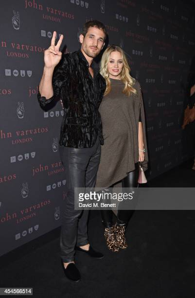 Max Rogers and Kimberly Wyatt attend as John Varvatos launch their first European store in London on September 3 2014 in London England