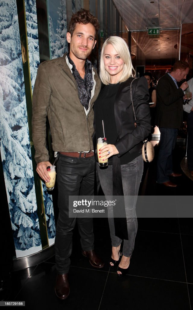 Max Rogers (L) and <a gi-track='captionPersonalityLinkClicked' href=/galleries/search?phrase=Kimberly+Wyatt&family=editorial&specificpeople=678958 ng-click='$event.stopPropagation()'>Kimberly Wyatt</a> attend the launch of the W Republic of Verbier takeover at W London - Leicester Square on October 24, 2013 in London, England.