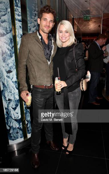 Max Rogers and Kimberly Wyatt attend the launch of the W Republic of Verbier takeover at W London Leicester Square on October 24 2013 in London...