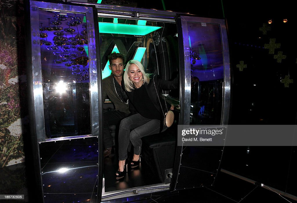 Max Rogers (L) and Kimberly Wyatt attend the launch of the W Republic of Verbier takeover at W London - Leicester Square on October 24, 2013 in London, England.