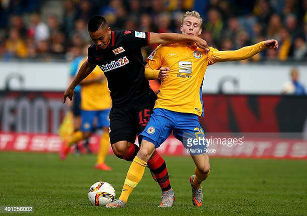 Max Sauer of Braunschweig challenges for the ball with Bobby Wood of Union Berlin during the Second Bundesliga match between Eintracht Braunschweig...