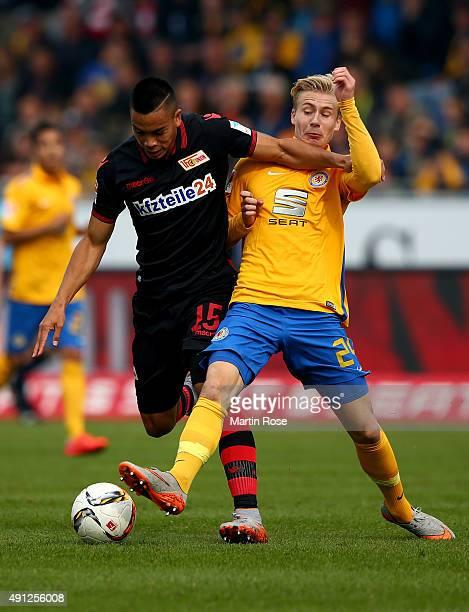 Max Sauer of Braunschweig challenges for the ball with Bobby Wood of Union Berlin during the Second Bundesliga match between Eintracht Braunschweig...