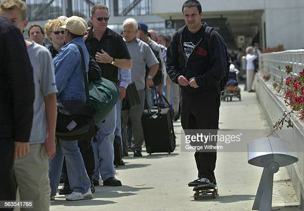 5/23/2003 – Max Schaf uses his skateboard to move along a line that stretched from terminal 1 to terminal 2 at LAX People were lined up to go through...