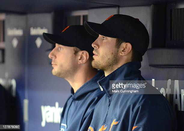 Max Scherzer and Rick Porcello of the Detroit Tigers look on from the dugout against the New York Yankees during Game One of the American League...