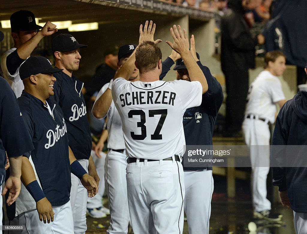 Max Scherzer #37 of the Detroit Tigers gets high-fives from teammates in the dugout during the game against the Chicago White Sox at Comerica Park on September 20, 2013 in Detroit, Michigan. The Tigers defeated the White Sox 12-5 for the 20th win of the season for Scherzer.