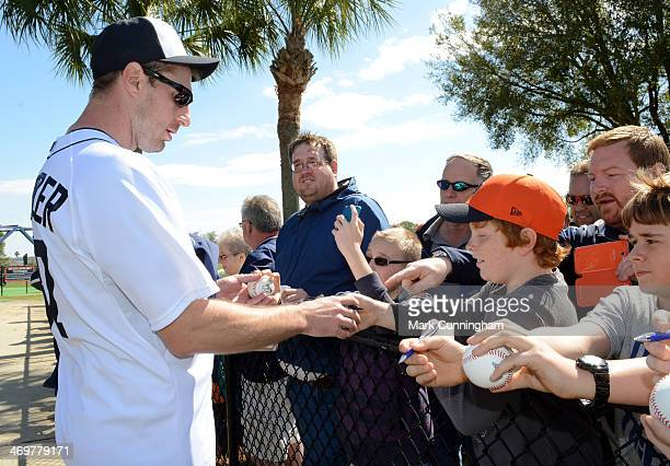 Max Scherzer of the Detroit Tigers signs autographs for fans after the spring training workout day at the TigerTown complex on February 15 2014 in...
