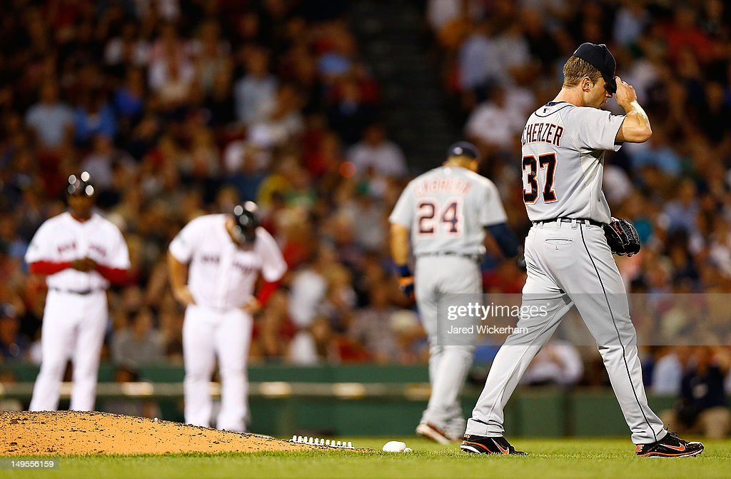 <a gi-track='captionPersonalityLinkClicked' href=/galleries/search?phrase=Max+Scherzer&family=editorial&specificpeople=594071 ng-click='$event.stopPropagation()'>Max Scherzer</a> #37 of the Detroit Tigers takes a moment after giving up a triple against the Boston Red Sox during the game on July 30, 2012 at Fenway Park in Boston, Massachusetts.
