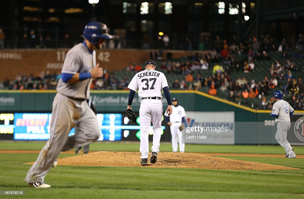 <a gi-track='captionPersonalityLinkClicked' href=/galleries/search?phrase=Max+Scherzer&family=editorial&specificpeople=594071 ng-click='$event.stopPropagation()'>Max Scherzer</a> #37 of the Detroit Tigers walks back to the mound after walking <a gi-track='captionPersonalityLinkClicked' href=/galleries/search?phrase=Eric+Hosmer&family=editorial&specificpeople=7091345 ng-click='$event.stopPropagation()'>Eric Hosmer</a> #35 of the Kansas City Royals with the bases loaded scoring <a gi-track='captionPersonalityLinkClicked' href=/galleries/search?phrase=Alex+Gordon+-+Baseball+Player&family=editorial&specificpeople=4494252 ng-click='$event.stopPropagation()'>Alex Gordon</a> #4 in the fifth inning during the game at Comerica Park on April 24, 2013 in Detroit, Michigan. The Tigers defeated the Royals 7-5.