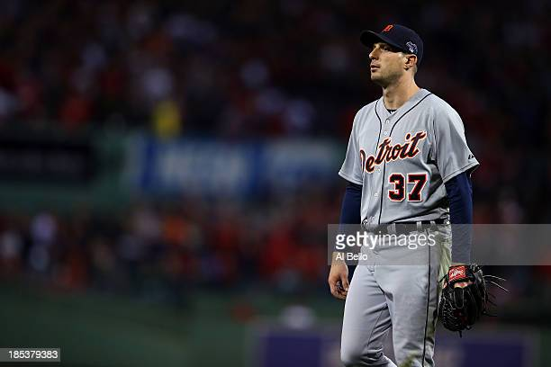 Max Scherzer of the Detroit Tigers walks to the dugout after being relieved in the seventh inning against the Boston Red Sox during Game Six of the...