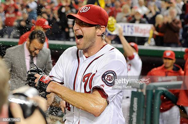 Max Scherzer of the Washington Nationals celebrates after tying the MLB record for strikeouts in a game with 20 against the Detroit Tigers at...