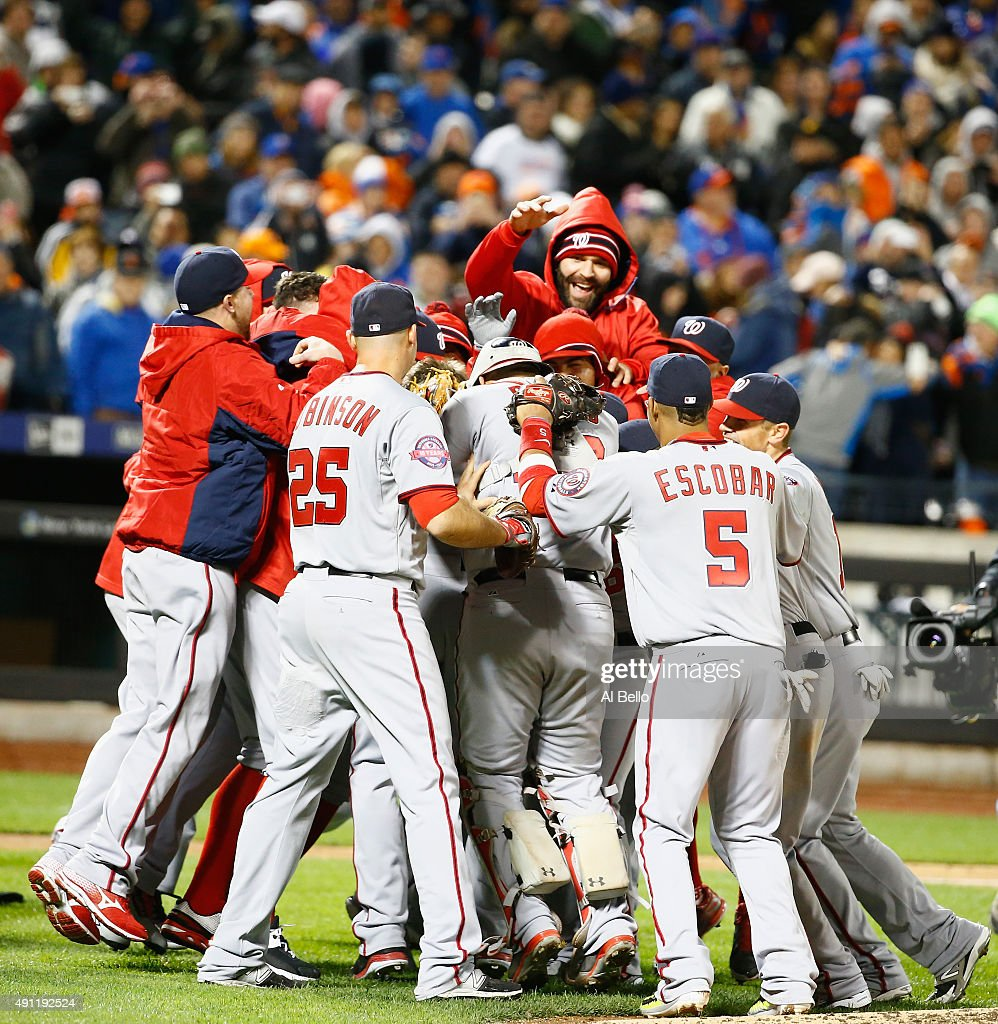Max Scherzer #31 of the Washington Nationals celebrates his no hitter with his teamates against the New York Mets after their game at Citi Field on October 3, 2015 in New York City.