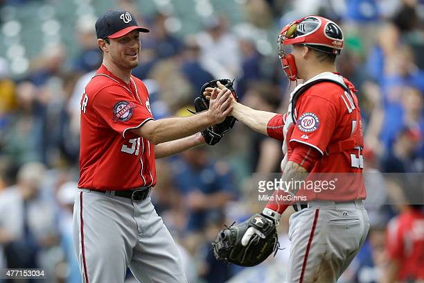 Max Scherzer of the Washington Nationals celebrates with Jose Lobaton after pitching a one hitter in the 40 win over the Milwaukee Brewers at Miller...