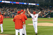 Max Scherzer of the Washington Nationals celebrates with teammates after tying the MLB record for strikeouts in a game with 20 against the Detroit...