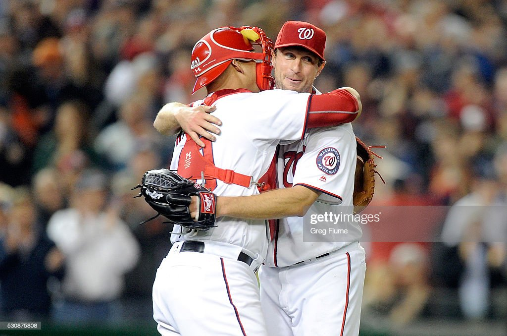 Max Scherzer #31 of the Washington Nationals celebrates with Wilson Ramos #40 after tying the MLB record for strikeouts in a game with 20 against the Detroit Tigers at Nationals Park on May 11, 2016 in Washington, DC.