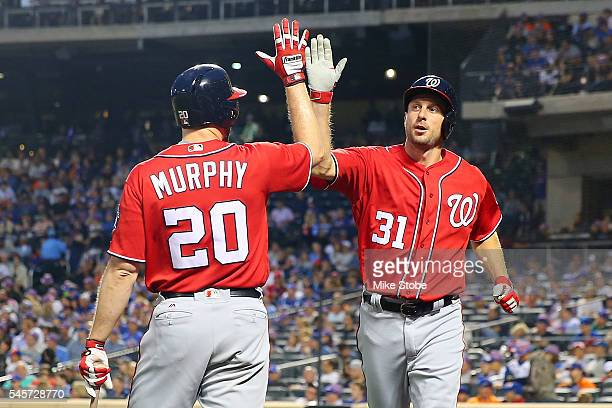Max Scherzer of the Washington Nationals is greeted by Daniel Murphy after scoring on Ben Revere RBI triple in the third inning against the New York...