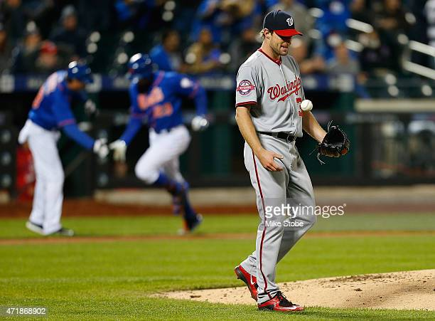 Max Scherzer of the Washington Nationals reacts as Michael Cuddyer of the New York Mets rounds third after hitting a fourth inning home run at Citi...