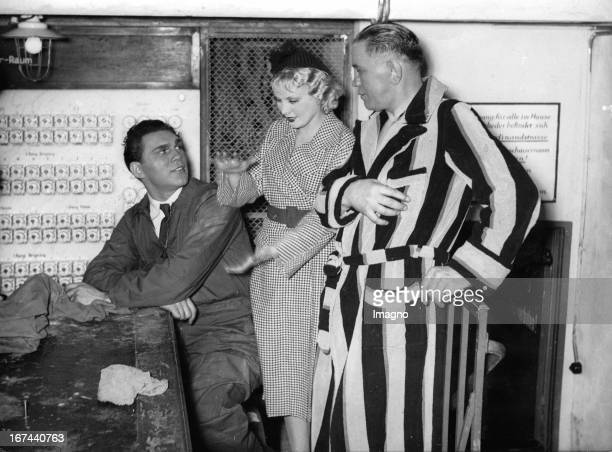 Max Schmeling and Anny Ondra and Paul SamsonKorner during a break in filming the movie A YOUNG GIRL A YOUNG MAN 1935 Photograph Max Schmeling und...