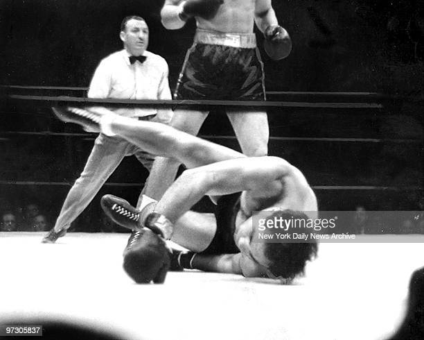 Max Schmeling looks as if he's out during fight against Joe Louis Louis won by a knockout in the first round of their rematch to retain his title