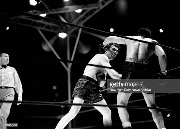 Max Schmeling versus Joe Louis I at Yankee Stadium Mighty Louis totters on rubbery legs in fourth round as Schmeling smashed home a right the mailed...