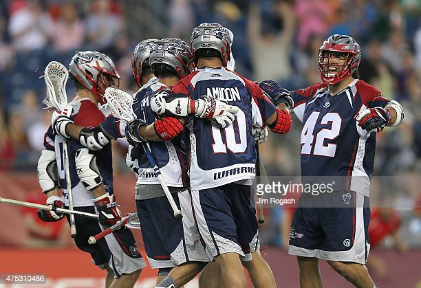 Max Seibald of Boston Cannons celebrates with Josh Amidon of Boston Cannons who scored a goal in the final minutes against the Florida Launch in the...